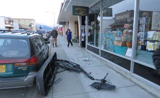 Strong winds crash ski carrier into bookstore window, boats across lot